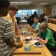 Students investigated how different surfaces and lubricants affect the frictional force between two objects at the Jenkins Science Center.